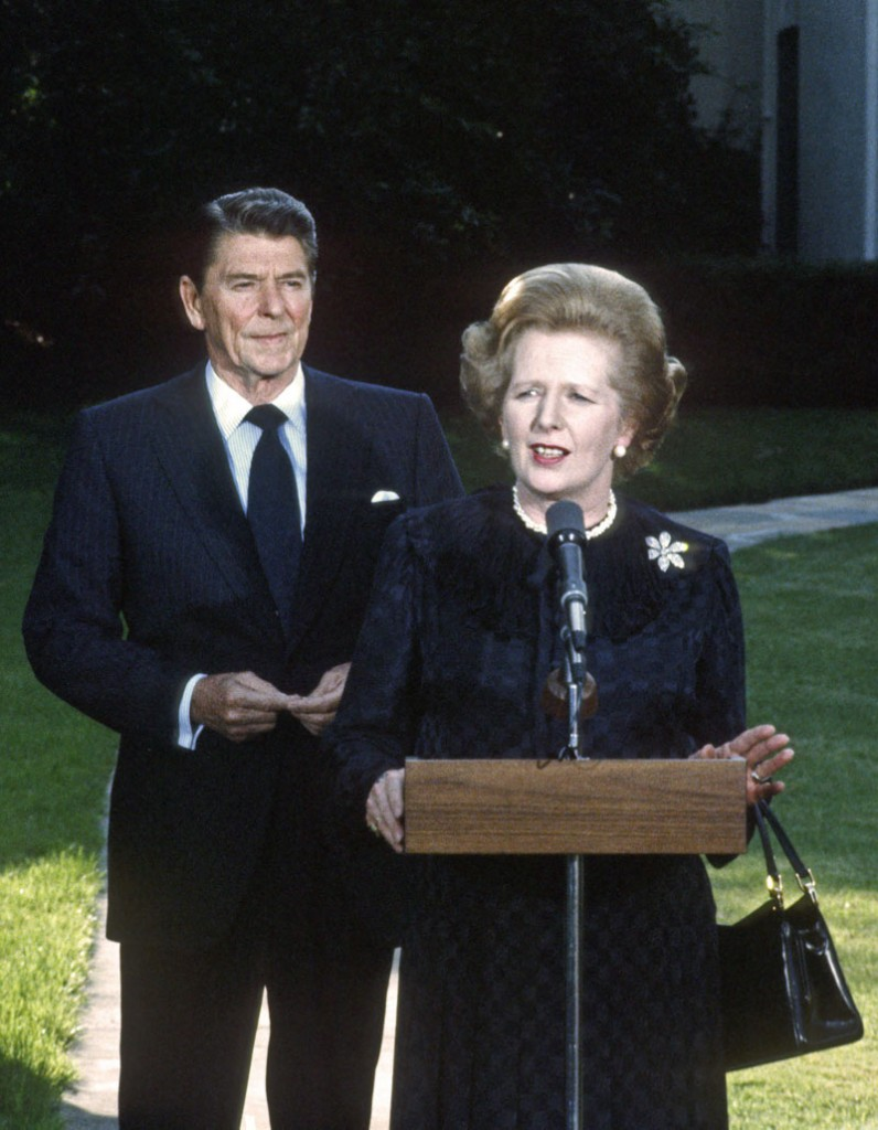 Prime Minister Margaret Thatcher of the United Kingdom, right, makes remarks as United States President Ronald Reagan looks on following their meeting at the White House in Washington, D.C. on Wednesday, June 23, 1982. Thatcher died from a stroke at 87 on Monday, April 8, 2013. Credit: Howard L. Sachs - CNP