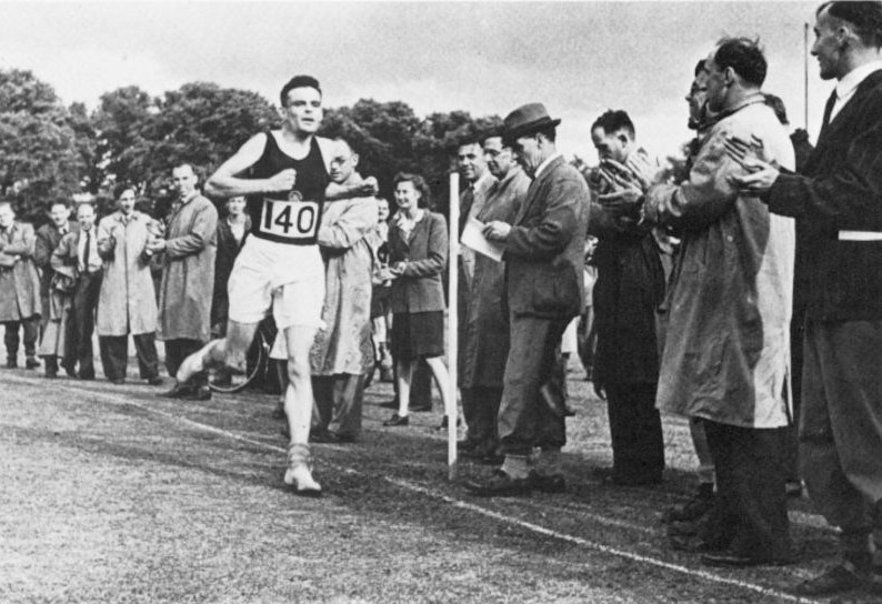 ALAN MATHISON TURING (1912-1954). English mathematician and logician. Finishing second in a three-mile race at Dorking, England in 1946.