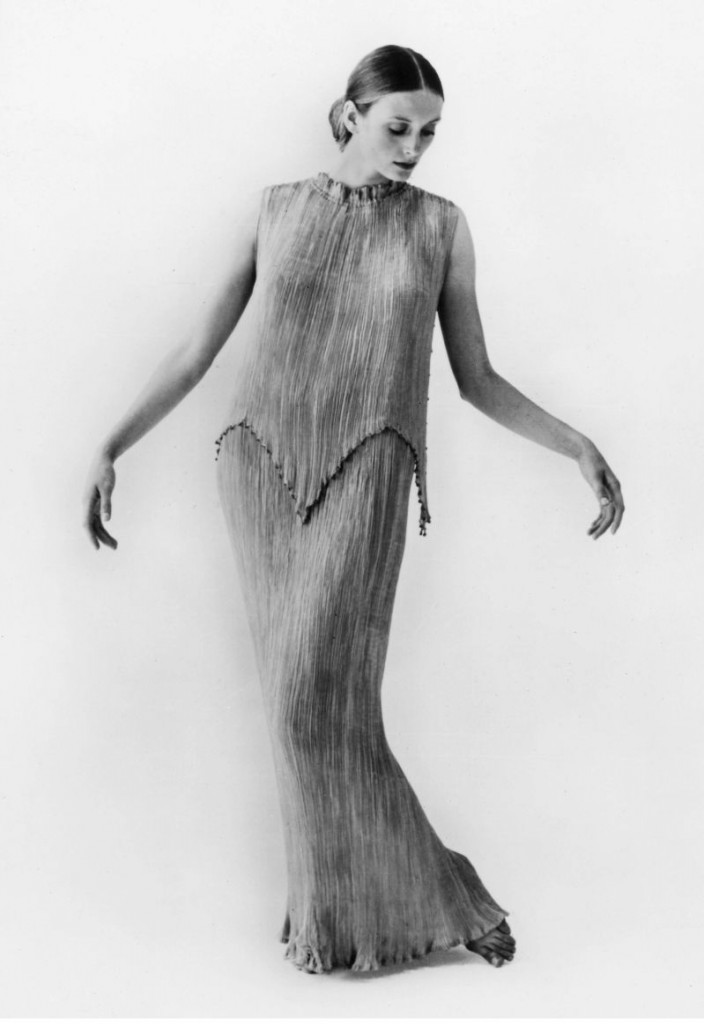 WOMEN'S FASHION, c1912.  Pleated apricot silk Mariano Fortuny y Madrazo dress. Photograph, c1912.