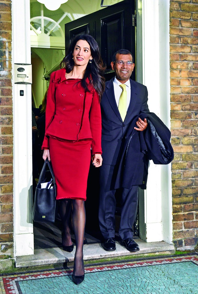 RETRANSMITTED CORRECTING CAPTION FROM UNIDENTIFIED WOMAN TO AMAL CLOONEY Former President of the Maldives Mohamed Nasheed (right) leaves a press conference with Amal Clooney, where he and his lawyers assessed the political situation in the Maldives and highlighted the human rights abuses still ongoing in a country most people associate with tropical paradise.