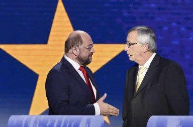 Top candidate of the German Social Democratic Party (SPD) for the 2014 European elections Martin Schulz (L) speaks with candidate for the centre-right European People's Party (EPP) Jean-Claude Juncker before a debate on May 15,2014 at the EU Headquarters in Brussels. AFP PHOTO/JOHN THYS