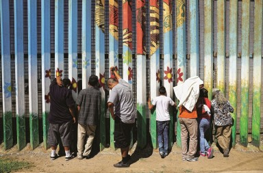 TIJUANA, MEXICO - SEPTEMBER 25: People meet loved ones through the U.S.-Mexico border fence on September 25, 2016 in Tijuana, Mexico. The U.S. Border Patrol opens the park on the American side in San Diego on weekends to meet through the fence with family and friends through the fence at Tijuana. The park is one of the few places on the 2,000-mile border where separated families are allowed to meet. (Photo by John Moore/Getty Images)