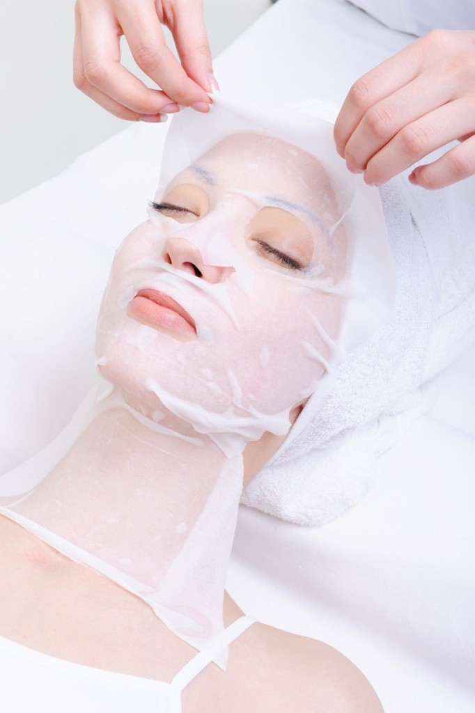 spa treatment for young woman's face in the beauty salon