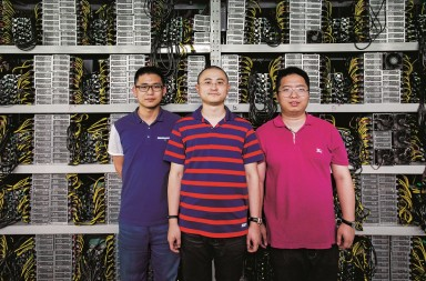 June 28, 2016 - Kangding, Sichuan, China: (L-R) Wang Ruixi, Ryan Xu and Boris Shen inside BitCoin mine which they have invested in outside the ethnic Tibetan frontier town Kangding in West Sichuan. This BitCoin mine comprises around 5,000 computers, which Xu claims generate around AU$60,000 a day. BitCoin Group will soon open a larger facility near by, which will house 8,000 super computers. (Dave Tacon/Polaris) ///