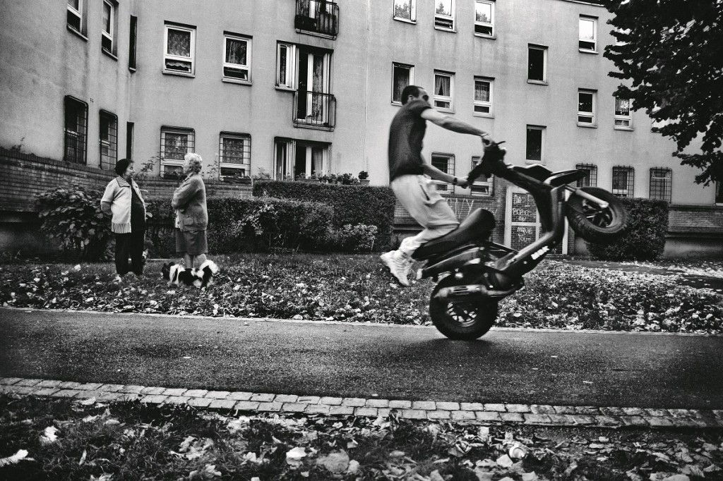 A man drives his scooter in the streets of Bobigny in Saint Denis, Paris, Île-de-France province, France on October 16, 2007. Oct. 27, 2005, in Clichy-sous-Bois, a northern suburb of Paris, Zyed Benna and Bouna Traoré, 15 and 17 years old respectively, died electrocuted, while they hid from police in an electrical transformer. In the next hours, friends and neighbors took to the streets in protest. This provoked clashes with security forces that quickly spread throughout Parisian suburbs. In the following days, the revolt burned through numerous periphery areas throughout the country, until Nov. 8, 2005 when the French government declared a state of an emergency.