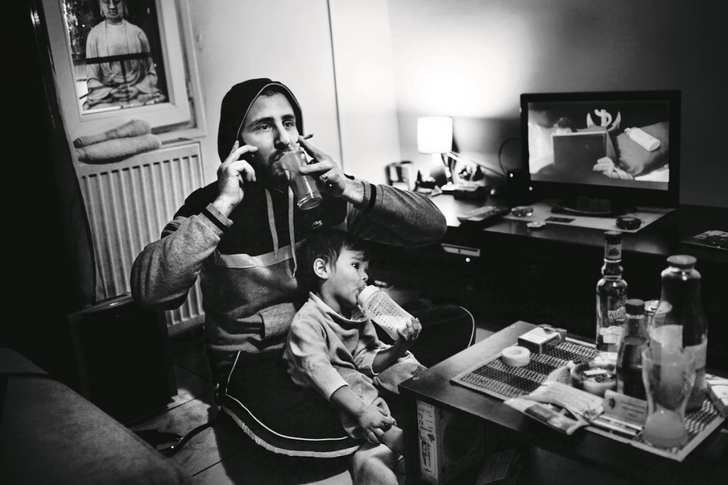 A father with his son talk by phone with her wife while drinks and smokes in his apartment in Saint Denis, Paris, Île-de-France province, France on November 2, 2012. Oct. 27, 2005, in Clichy-sous-Bois, a northern suburb of Paris, Zyed Benna and Bouna Traoré, 15 and 17 years old respectively, died electrocuted, while they hid from police in an electrical transformer. In the next hours, friends and neighbors took to the streets in protest. This provoked clashes with security forces that quickly spread throughout Parisian suburbs. In the following days, the revolt burned through numerous periphery areas throughout the country, until Nov. 8, 2005 when the French government declared a state of an emergency.