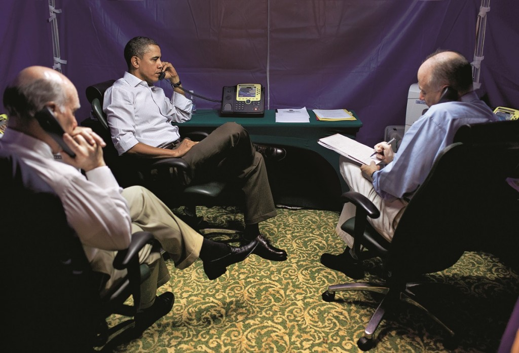 Caption supplied by the White House: ìPresident Barack Obama is briefed on the situation in Libya during a secure conference call with National Security Advisor Tom Donilon, right, Chief of Staff Bill Daley, left, Secretary of State Hillary Clinton, Secretary of Defense Bob Gates, AFRICOM Commander General Carter Ham, and Deputy National Security Advisor Denis McDonough, in Rio de Janeiro, Brazil, Sunday, March 20, 2011. (Official White House Photo by Pete Souza)î
