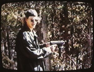 Video still from a tape released from the Jefferson County Sherrif's Department. The video shows Columbine killers Dylan Klebold and Eric Harris with others shooting weapons at Rampart Range about six weeks before the two went on their deadly spree at Columbine High School, killing twelve students and one teacher on April 20, 1999. Several of the weapons in the video are illegally modified, but the video appears to be a lighthearted romp through the forest with some very deadly weapons. The video was released to the media today, but is also available to te public for a $20 processing fee. Klebold prepares to fire one of the subcompact weapons at Rampart Range. ///