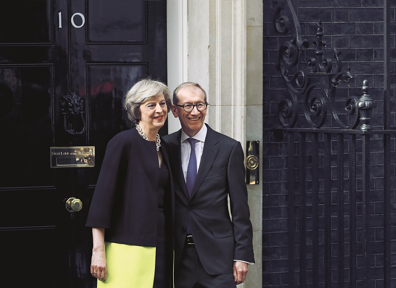 Britain's Prime Minister, Theresa May, and husband Philip pose for the media outside number 10 Downing Street, in central London, Britain July 13, 2016. REUTERS/Stefan Wermuth - RTSHSVN