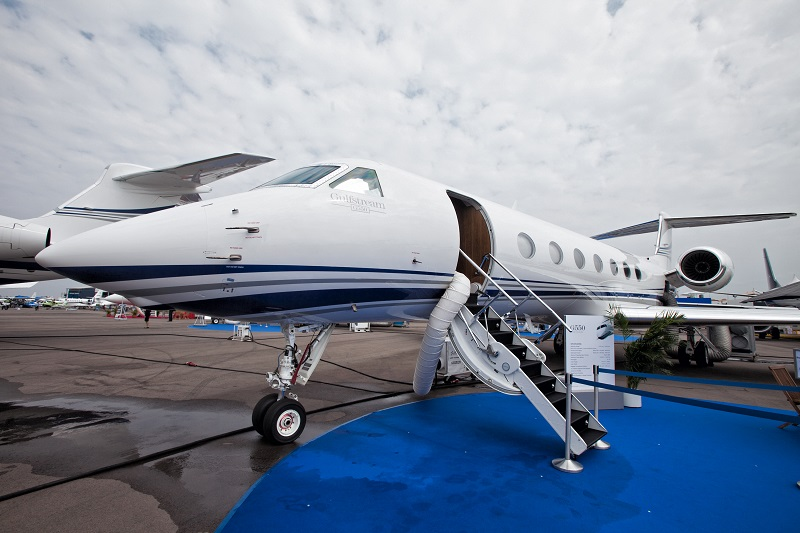 A Gulfstream G550 jet manufactured by Gulfstream Aerospace Corp., a unit of General Dynamics Corp., stands on display at the Singapore Airshow held at the Changi Exhibition Centre in Singapore, on Tuesday, Feb. 11, 2014. The air show takes place from Feb. 11-16. Photographer: Nicky Loh/Bloomberg via Getty Images