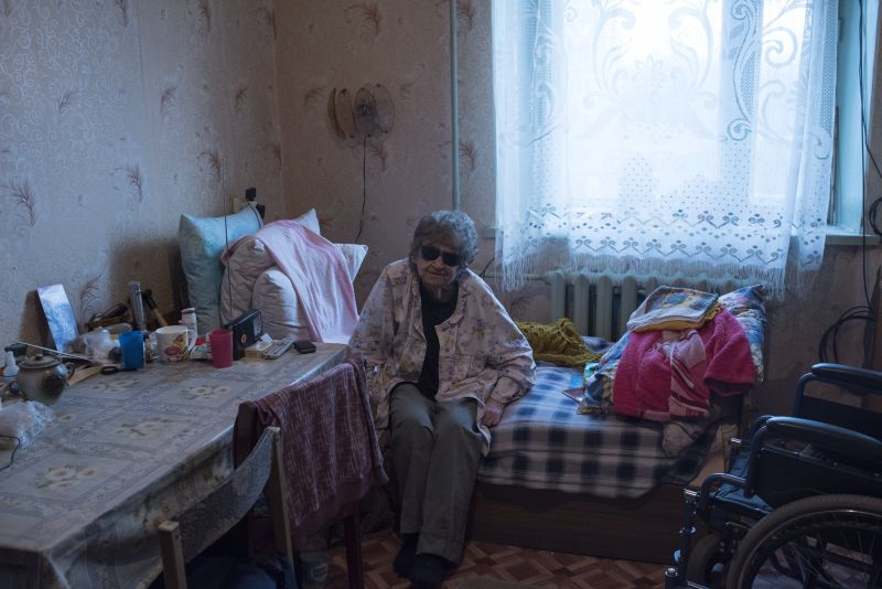 Ola Magadan region July 2015 Natasha Khayutina , the adopted daughter of Stalinist secret police chief Nikolai Yezhov, a man responsible for the deaths of many thousands; the last year of his rule, 1938, was known as rasstrelny – death-by-firing-squad – year, and the following year he met the firing squad himself, as did twenty thousand NKVD agents in Stalin's purges. Natasha became Child 144 in the orphanages, shunned by all, including the man she loved, who left the day he discovered her true identity. Shadowed by the KGB, she made her way to the remotest point of the USSR to escape her father's shadow. Natasha didn't know her own birthday, so she decided to celebrate hers along with her father's. in the 1950s, Natasha visited cousin Josef and his mother in Moscow. There she visited her mother's grave and received an accordion as a gift from her Moscow relatives. The accordion would remain her trademark for the rest of her life. Natasha has spent the rest of her life in the Magadan region. The country learned that the adopted daughter of Nikolai Ezhov was alive in 1998. Natasha had applied to the courts to rehabilitate her father. When the courts denied her request. Natasha realized that her father could never be rehabilitated but she continued to fight for herself. Natasha lives in Ola and her daughter and grandchildren live nearby.