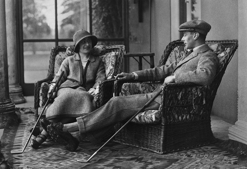 1923 --- Albert and Elizabeth, Duke and Duchess of York, relax after a round of golf during their honeymoon. They are the future King George VI and Queen Elizabeth of England. --- Image by © Hulton-Deutsch Collection/CORBIS