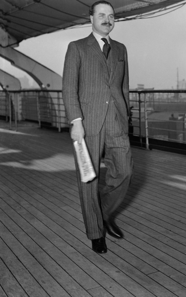 November 1937, New York, USA --- Captain Ernest Simpson, the former husband of the Duchess of Windsor, aboard the SS . If the gossips are correct, this is a prenuptial trip for the captain, for it is said, he is to marry Mary Kirk Raffray, the girlhood friend of his former wife, when her divorce becomes final. --- Image by © Bettmann/CORBIS