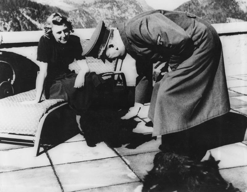 Adolf Hitler and Eva Braun with their dogs at their Bavarian retreat in Berchtesgaden