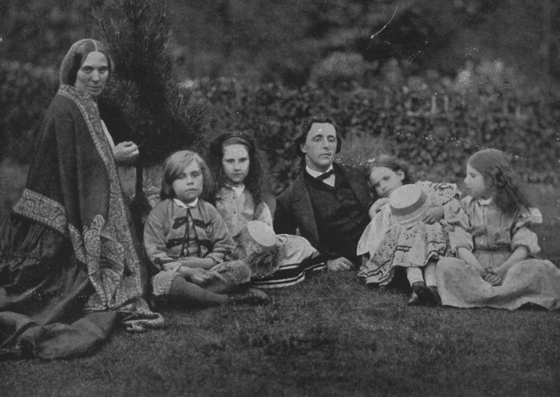 English mathematician, writer and photographer Charles Lutwidge Dodgson, better known as Lewis Carroll (1832 - 1898) with Mrs George Macdonald and four children relaxing in a garden. (Photo by Lewis Carroll/Hulton Archive/Getty Images)
