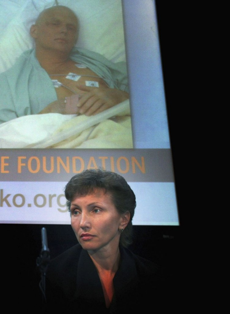 LONDON - APRIL 03: Marina Litvinenko, the widow of murdered former spy Alexander Litvinenko, sits under a image of her deceased husband at the launch of Alexander Litvinenko Foundation at the Royal United Services Institutes on April 3, 2007 in London, England. Marina Litvinenko, together with close friend Alex Goldfarb and Russian billionaire Boris Berezovsky, are setting the foundation up to aid the investigation into Mr Litvinenko's death. (Photo by Matt Cardy/Getty Images)