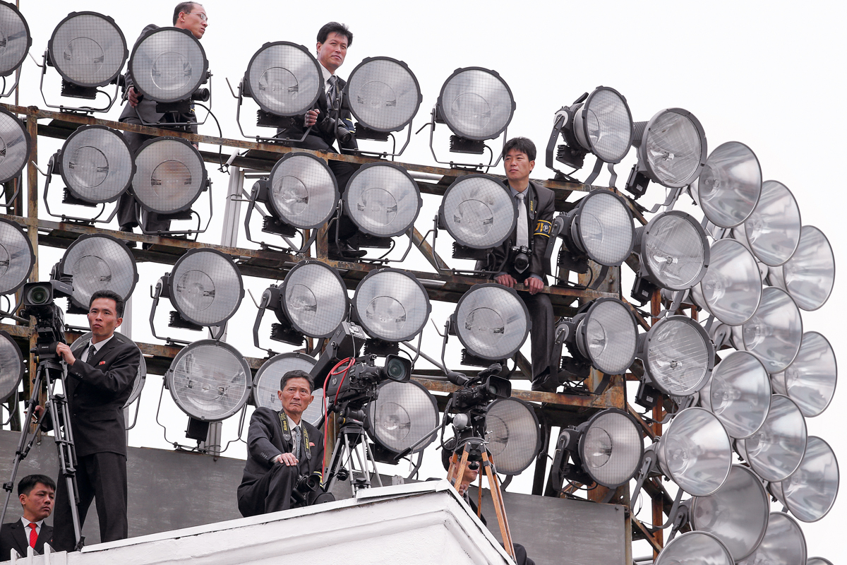 Cameramen take position atop one of buildings in the capital's main ceremonial square during a mass rally and parade, a day after the ruling party wrapped up its first congress in 36 years by elevating him to party chairman, in Pyongyang, North Korea, May 10, 2016. REUTERS/Damir Sagolj - S1BETDGLJHAA