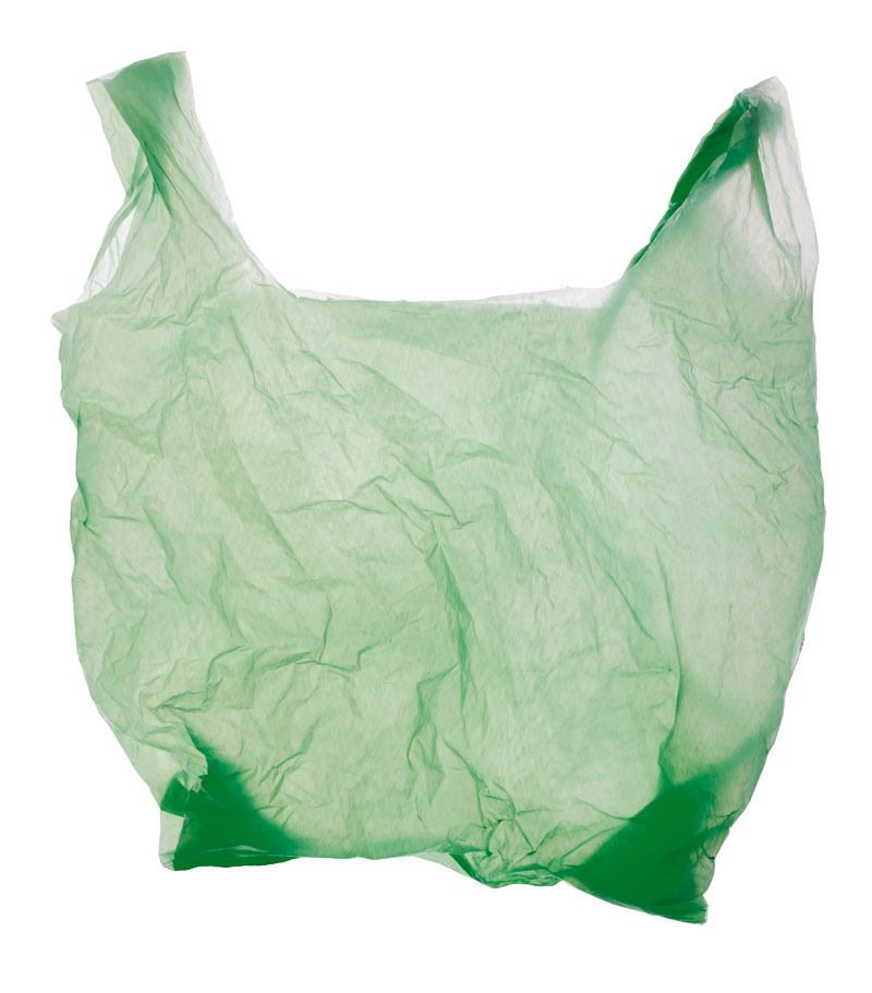 Green plastic bag isolated on white.