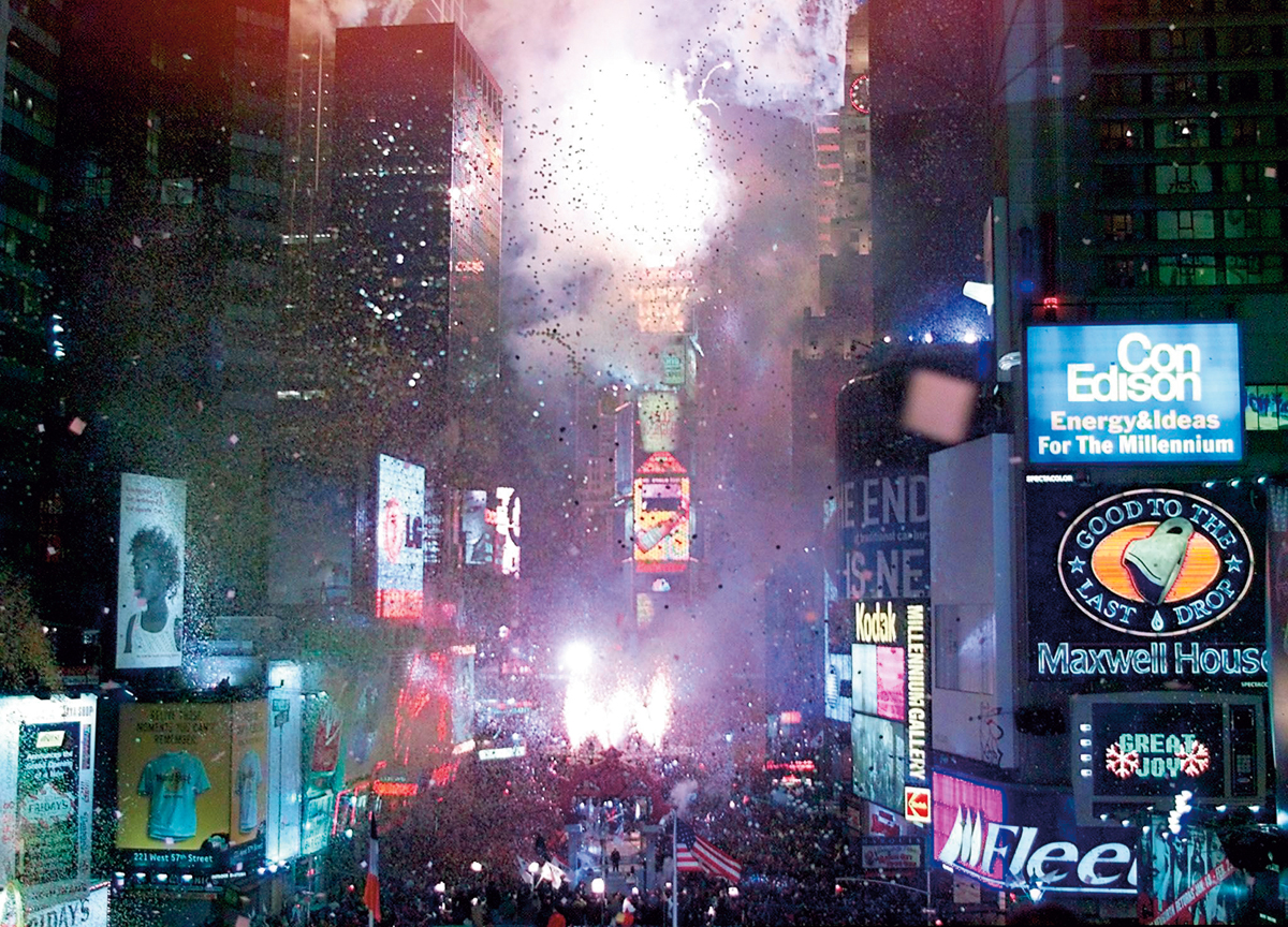 NEW YORK, UNITED STATES:  Times Square lights up as the Millennium ball drops to light up the 2000 sign as New Year's is celebrated in New York City at the Times Square 2000 celebration 01 January 2000. About 2 million people are expected to ring in the new millennium in Times Square.  AFP PHOTO/Timothy A. Clary (Photo credit should read TIMOTHY A. CLARY/AFP/Getty Images)