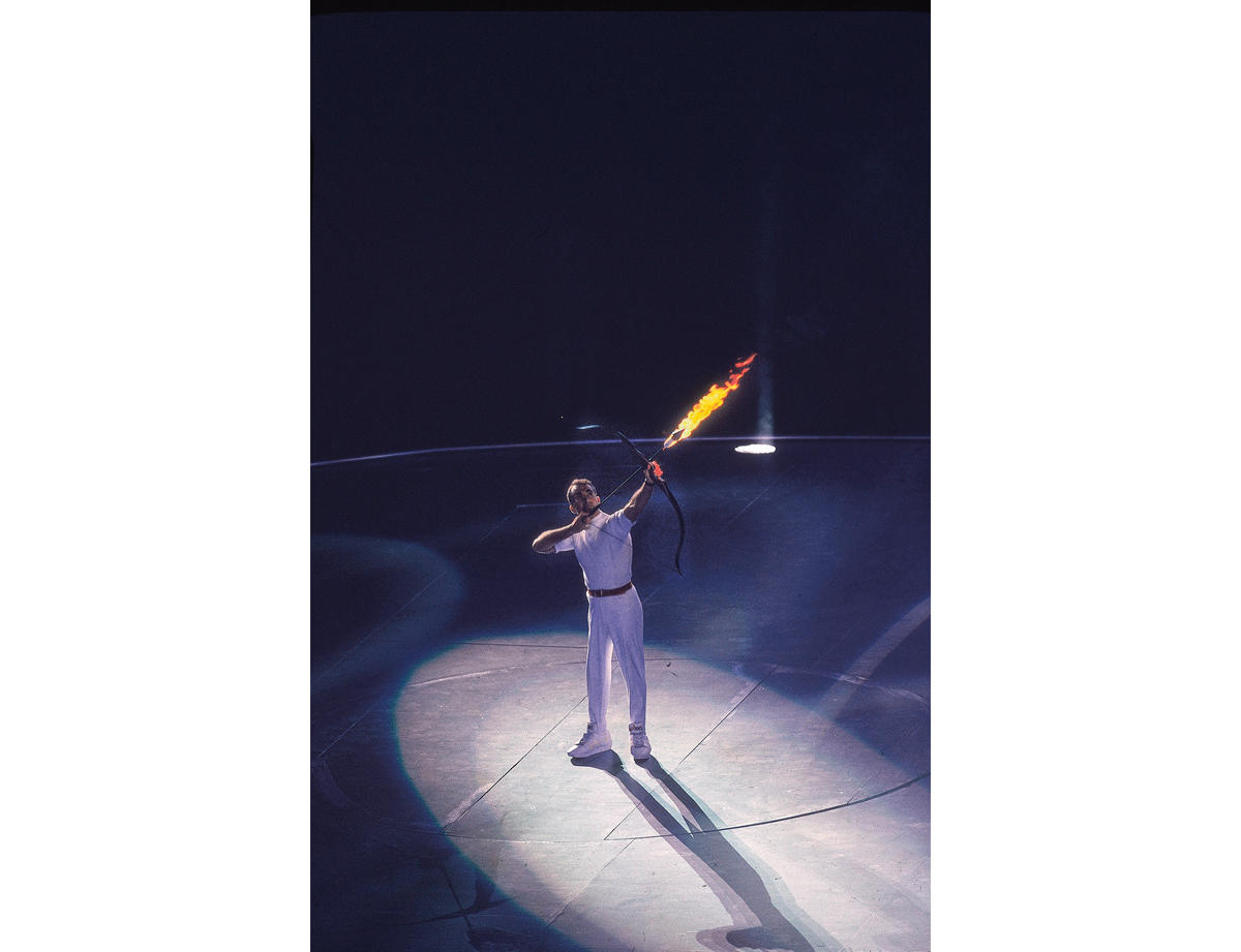 SPAIN - JULY 25:  Opening Ceremony: 1992 Summer Olympics, Paralympic archer Antonio Rebollo shooting lit arrow and lighting flame at Olympic Stadium, Barcelona, Spain 7/25/1992  (Photo by Peter Read Miller/Sports Illustrated/Getty Images)  (SetNumber: X43182 TK1 R5 F34)