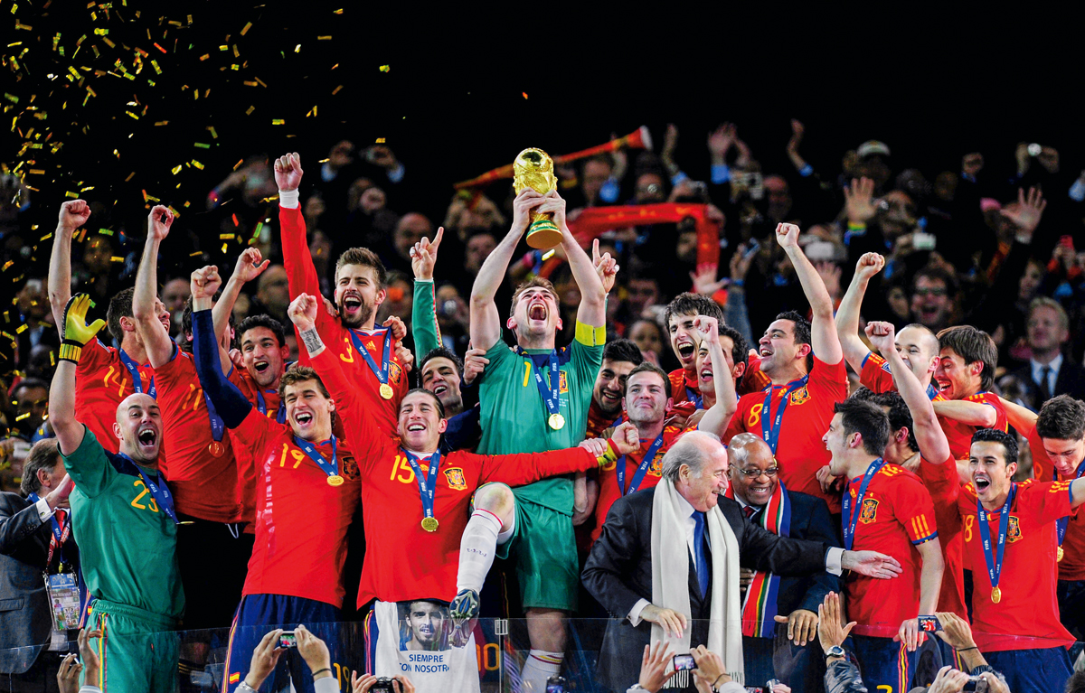 JOHANNESBURG, SOUTH AFRICA - JULY 11:  Iker Casillas of Spain celebrates lifting the World Cup with team mates during the 2010 FIFA World Cup South Africa Final match between Netherlands and Spain at Soccer City Stadium on July 11, 2010 in Johannesburg, South Africa.  (Photo by Jamie McDonald/Getty Images)