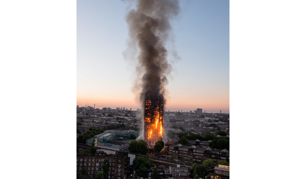 "Residents were trapped  as flames raged through a 27-storey tower block in Notting Hill in the early hours today. Witnesses described ""horrible scenes"" as firefighters battled the inferno at Grenfell Tower in the Lancaster West estate near Ladbroke Grove. London Fire Brigade confirmed ""a number of fatalities"" this morning. They could not say how many people were killed due to the ""complexity"" of the operation. Forty fire engines with 200 officers were called shortly before 1am as flames engulfed the block from the second floor upwards ""within seconds"". London Ambulance Service said 50 people had been taken to five hospitals following the fire. Witnesses reported other people trapped on the upper storeys. 14th June 2017.   © Jeremy Selwyn / Evening Standard / eyevine  Contact eyevine for more information about using this image: T: +44 (0) 20 8709 8709 E: info@eyevine.com http://www.eyevine.com"