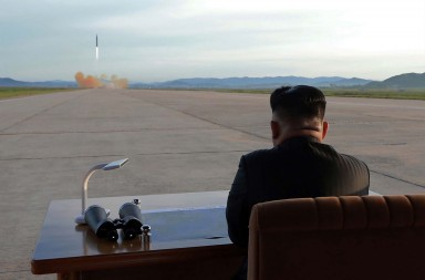 "TOPSHOT - This undated picture released from North Korea's official Korean Central News Agency (KCNA) on September 16, 2017 shows North Korean leader Kim Jong-Un inspecting a launching drill of the medium-and-long range strategic ballistic rocket Hwasong-12 at an undisclosed location. Kim vowed to complete North Korea's nuclear force despite sanctions, saying the final goal of his country's weapons development is ""equilibrium of real force"" with the United States, state media reported on September 16.  / AFP PHOTO / KCNA VIA KNS / STR / South Korea OUT / REPUBLIC OF KOREA OUT   ---EDITORS NOTE--- RESTRICTED TO EDITORIAL USE - MANDATORY CREDIT ""AFP PHOTO/KCNA VIA KNS"" - NO MARKETING NO ADVERTISING CAMPAIGNS - DISTRIBUTED AS A SERVICE TO CLIENTS THIS PICTURE WAS MADE AVAILABLE BY A THIRD PARTY. AFP CAN NOT INDEPENDENTLY VERIFY THE AUTHENTICITY, LOCATION, DATE AND CONTENT OF THIS IMAGE. THIS PHOTO IS DISTRIBUTED EXACTLY AS RECEIVED BY AFP.  /          (Photo credit should read STR/AFP/Getty Images)"