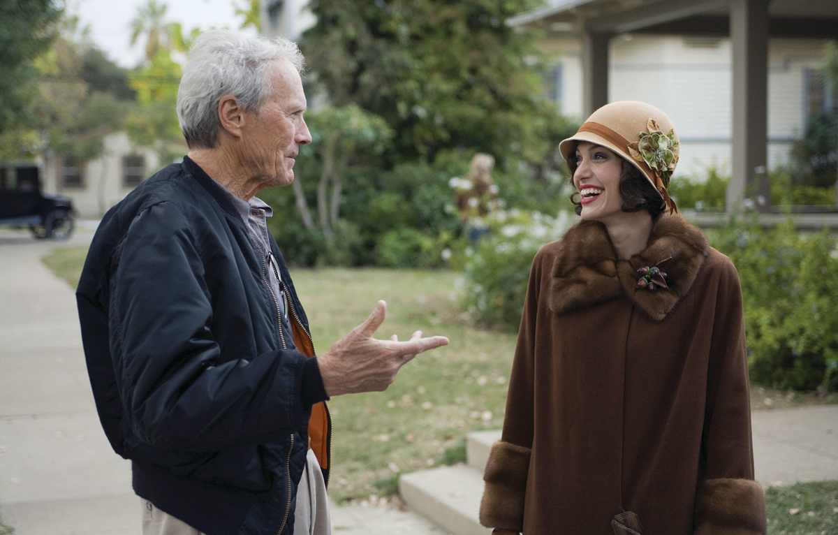 Director/producer CLINT EASTWOOD and ANGELINA JOLIE as Christine Collins on the set of the provocative drama based on the actual events that rocked California?s legal system, ?Changeling?.