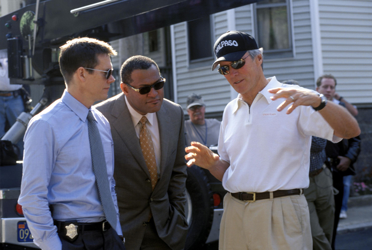 From left to right: KEVIN BACON, LAURENCE FISHBURNE and Director CLINT EASTWOOD behind the scenes on the set of Warner Bros. Pictures' and Village Roadshow Pictures' drama Mystic River, a Malpaso Production starring Sean Penn, Tim Robbins, Kevin Bacon and Laurence Fishburne. PHOTOGRAPHS TO BE USED SOLELY FOR ADVERTISING, PROMOTION, PUBLICITY OR REVIEWS OF THIS SPECIFIC MOTION PICTURE AND TO REMAIN THE PROPERTY OF THE STUDIO. NOT FOR SALE OR REDISTRIBUTION