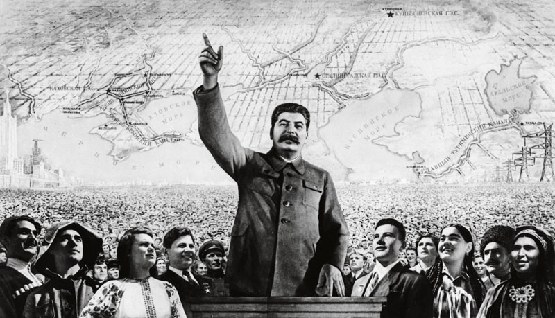 A soviet propaganda poster featuring joseph stalin published by the iskusstvo publishing house, 1950 (?), 'under the leadership of great stalin - forward to communism'. (Photo by: Sovfoto/UIG via Getty Images)
