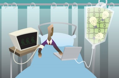 BM12TW Businessman using a laptop in a hospital bed