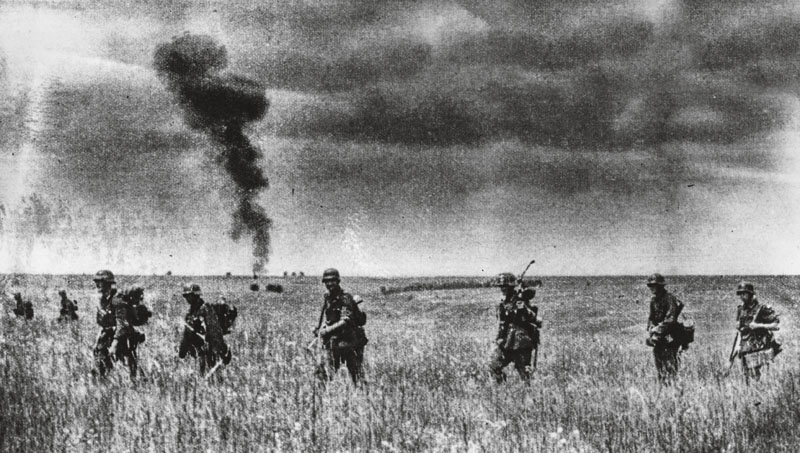 August 1942: Nazi troops advance through the richest wheat producing territory of Russia, in the Don river area. A plume of smoke rises from the horizon. (Photo by Keystone/Getty Images)