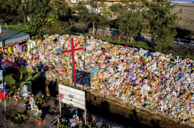 "Aerial view of the ""animita"" to Astrid Soto, a young girl who died in a traffic accident in 1998, where hundreds of people go to ask for miracles and leave stuffed animals in gratitude in Santiago, on August 03, 2018. - ""Animita"" is the Chilean term for a place of religious veneration, generally developed as a chapel, hermitage, sanctuary or shrine to the dead along a road. (Photo by Martin BERNETTI / AFP)        (Photo credit should read MARTIN BERNETTI/AFP/Getty Images)"