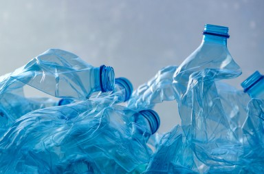 Crushed plastic bottles heap ready for recycling