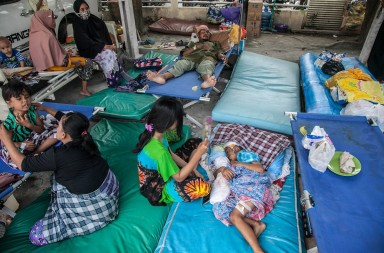October 4, 2018 - Palu, Central Sulawesi, Indonesia - Child recovers lying being injured in the massive, after the earthquake hit the area on September 28, lying in her health at a hospital in Balaroa Village on October 4, 2018, Central Sulawesi, Indonesia. Life is hold for living in tents and shelters in the Indonesian city hit by a powerful earthquake and tsunami, unsure when they'll be able to rebuild and spending hours each day often futilely trying to secure necessities such as fuel for generators. A total of 1,411 people have been confirmed dead and over 2,500 injured after the monster earthquake struck on September 28 sending destructive waves barrelling into Sulawesi island. (Credit Image: © Ivan Damanik/ZUMA Wire)