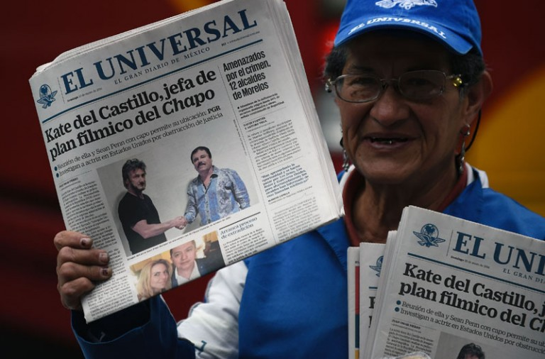 "A vendor sells newspapers showing a picture of drug lord Joaquin Guzman, aka ""El Chapo"" (R), shaking hands with US actor Sean Penn, in Mexico City on January 10, 2016. The Hollywood-worthy recapture of ""El Chapo"" took a stunning turn Sunday as authorities sought to question Penn over his interview with the Mexican drug kingpin. A federal official told AFP that the attorney general's office wants to talk with Penn and Mexican actress Kate del Castillo about their secretive meeting with Guzman in October, three months before his capture on January 8.   AFP PHOTO / ALFREDO ESTRELLA / AFP / ALFREDO ESTRELLA        (Photo credit should read ALFREDO ESTRELLA/AFP/Getty Images)"