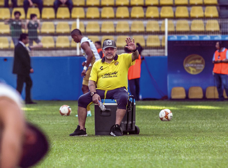 Argentine legend Diego Maradona, coach of Mexican second-division club Dorados, gives instructions to the players during a match against Universidad de Guadalajara, at the Banorte stadium in Culiacan, Sinaloa State, Mexico, on September 29, 2018. (Photo by RASHIDE FARIAS / AFP) (Photo credit should read RASHIDE FARIAS/AFP/Getty Images)