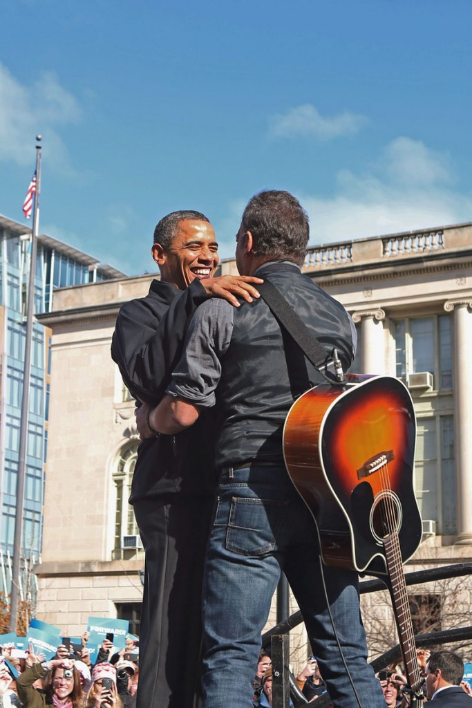 MADISON, WI - NOVEMBER 05: Rocker Bruce Springsteen (R) welcomes U.S. President Barack Obama to the stage during a rally on the last day of campaigning in the general election November 5, 2012 in Madison, Wisconsin. Obama and his opponent, Republican presidential nominee and former Massachusetts Gov. Mitt Romney are stumping from one 'swing state' to the next in a last-minute rush to persuade undecided voters. (Photo by Chip Somodevilla/Getty Images)