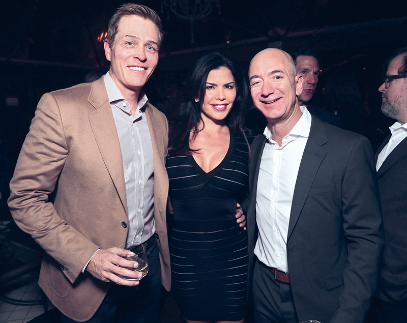 """LOS ANGELES, CA - DECEMBER 03: (EXCLUSIVE COVERAGE) WME's Patrick Whitesell, Lauren Sanchez and Amazon CEO Jeff Bezos attend Jeff Bezos and Matt Damon's """"Manchester By The Sea"""" Holiday Party on December 3, 2016 in Los Angeles, California. (Photo by Todd Williamson/Getty Images for Amazon Studios)"""