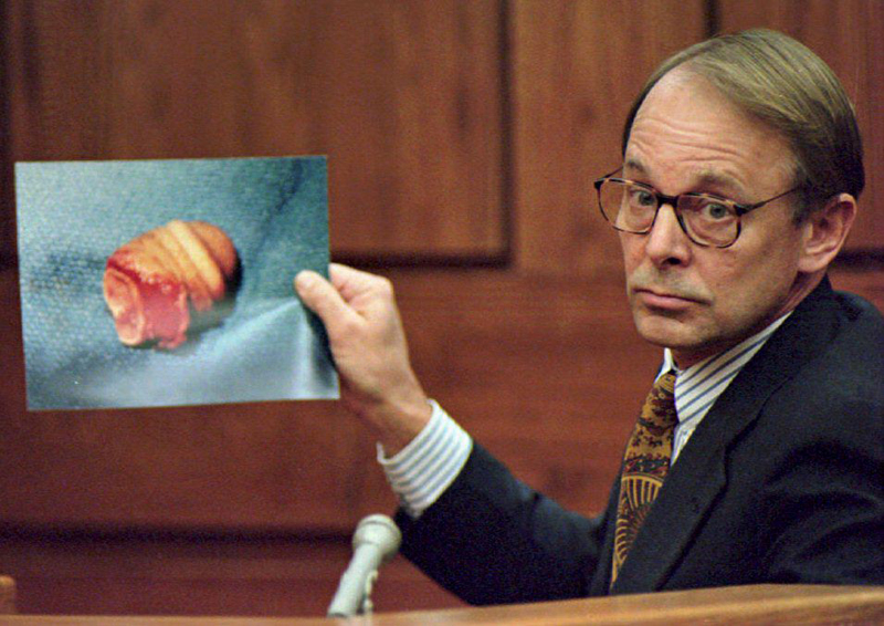 Dr. James T. Sehn holds a photo of the severed pen