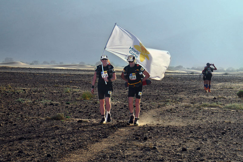 Handout photo issued by Marie Curie Cancer Care of Sir Ranulph Fiennes and trainer Rory Coleman approaching camp 4 during the fourth day for the Marathon des Sables - a gruelling six-day ultra-marathon in the Moroccan desert.